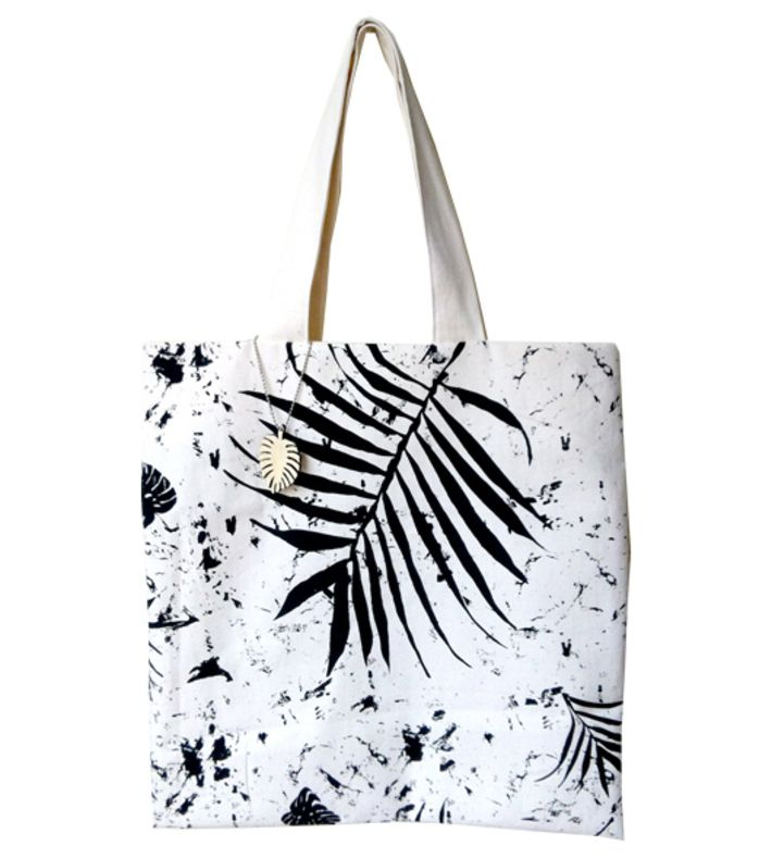 This tropicana bag is designed and silk screened by Jesse Hendriks. It's made of unbleached cotton and silk screened with black paint. A little extra is the nice wooden keychain that comes with the bag.  You can buy this tote bag at www.artrebels.com #artrebels #totebag #art