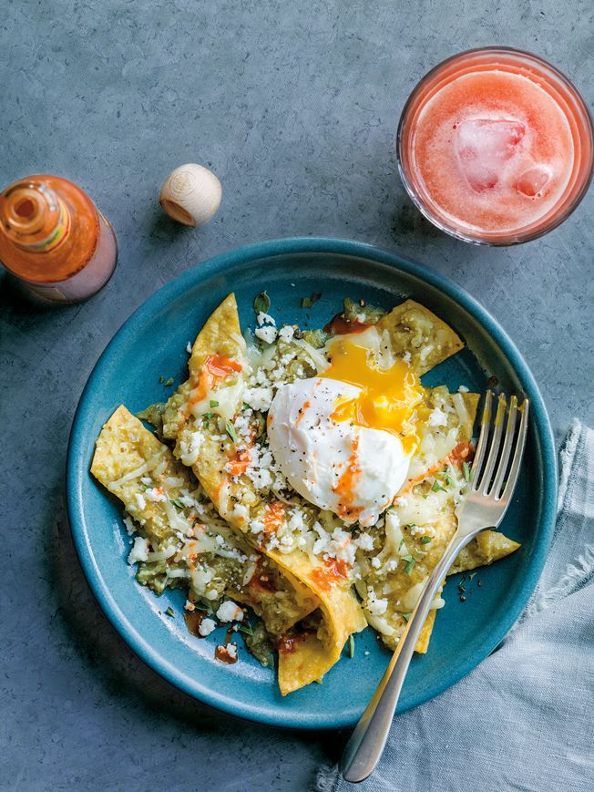 Quickly made from simple ingredients on hand, this chilaquiles recipe is a terrific way to use up old tortillas. Served with poached eggs, it makes a colorful and hearty brunch dish for a winter morning. To save time you can use purchased salsa instead of making the tomatillo sauce.