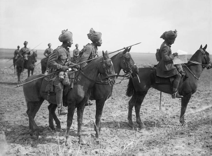 MINISTRY INFORMATION FIRST WORLD WAR OFFICIAL COLLECTION (Q 2061)   Forward scouts of the 9th Hodson's Horse, an Indian cavalry regiment, pause to consult a map, near Vraignes, April 1917