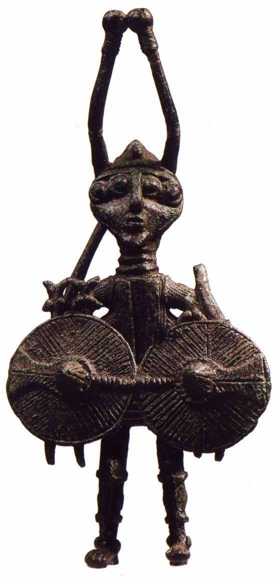 SARDINIAN WARRIOR C.800BC ~ Looking closely there are swordfish on the two shields. The helmet has, what looks to me like, the eyes of a crab and the mask he is wearing has four eyes.