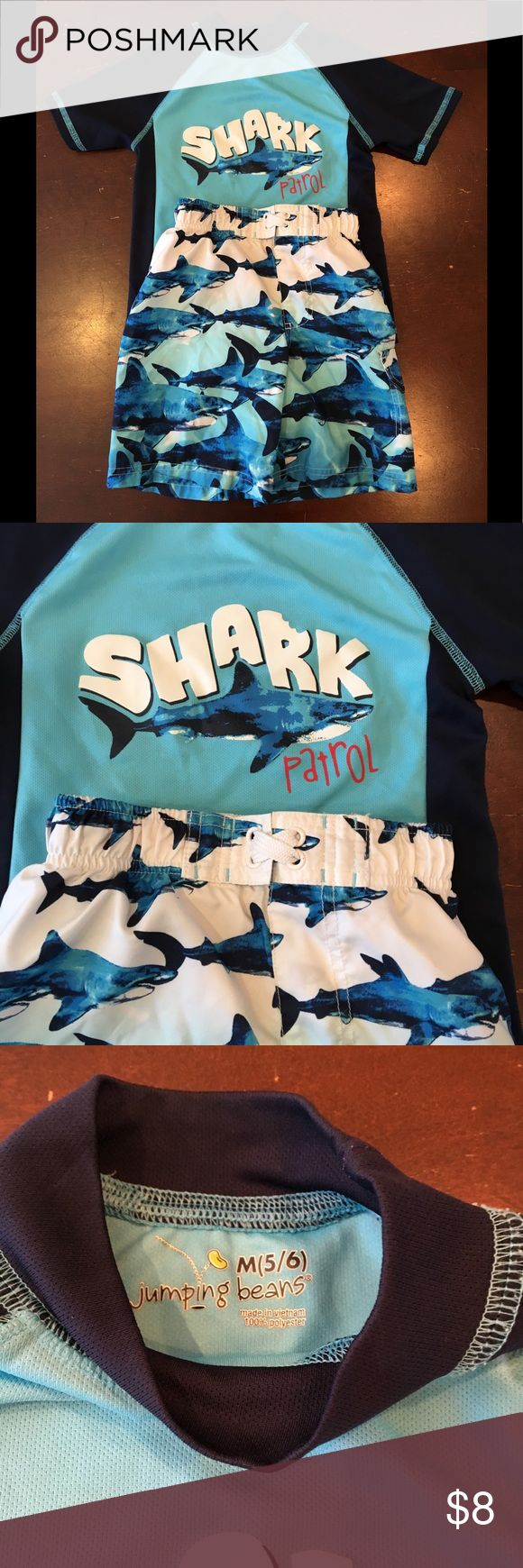 Shark patrol!  Swim set Jumping beans swim trunks and rash guard shirt.  Trucks are size 4 and top is size 5/6.  (My son is long in the torso...). In great shape and ready for more swimming fun! Jumping Beans Swim