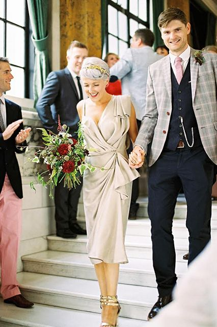love the quirkiness of BOTH their wedding outfits!