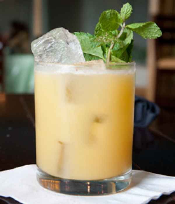 2  2-4 oz. of Pusser's Rum 4 oz. pineapple juice 1 oz. cream of coconut 1 oz. orange juice Grated fresh nutmeg