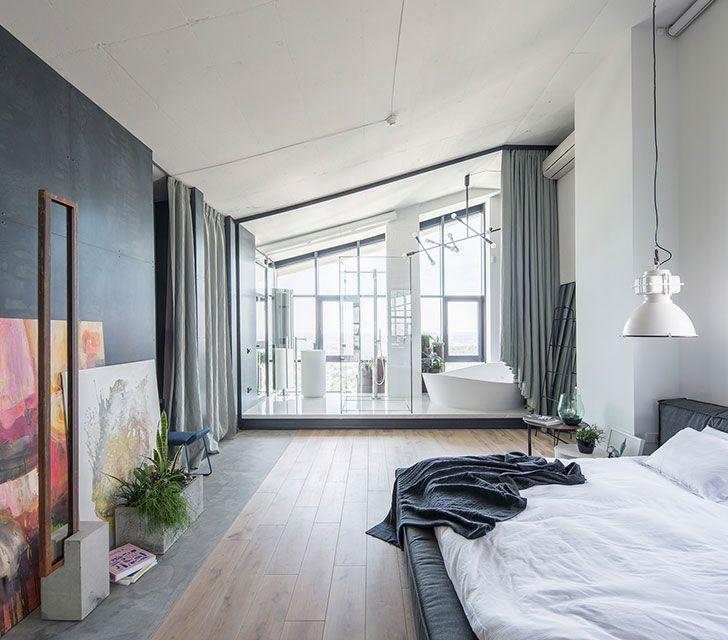 Industrial bedroom (see more) #apartment #kyiv #ukraine #flat #top #floor #high ceiling #bed #interior #design #decor #floor #wooden #panels #light #bath #tub #curtains #slopped #loft #raw #concrete
