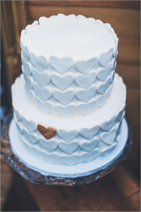one gold heart wedding cake #whitecake #heartcake http://www.weddingchicks.com/2013/11/26/gold-and-gray-wedding/