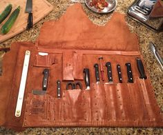 Backstory to this Knife Roll:My step-daughter is highly creative and competent in the kitchen. She can turn pretty much anything into a fabulous meal. For her high school graduation present I made a leather knife roll so she could take her favorite tools to college. The leather will protect the blades and provide a safe transport for years to come.Along with slots for her knives the roll has a detachable gadget bag, business card holder, place to put notes, and a thermometer holder. Laser…