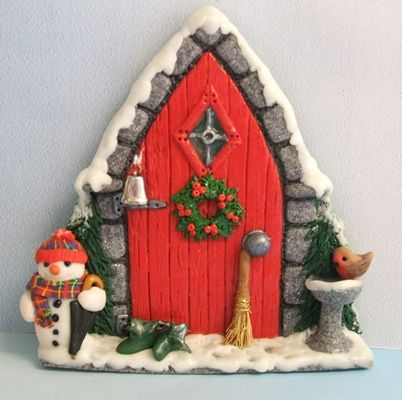 Handmade in polymer clay. The little fairy owner has been busy making a snowman instead of sweeping the snow from the steps as she intended. She has now gone inside to have a cup of hot chocolate to heat her up.