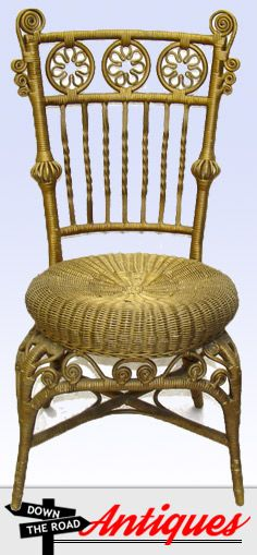 This great wicker child's photographer chair has a busy design and a gold finish with carved wood spindles along the back.