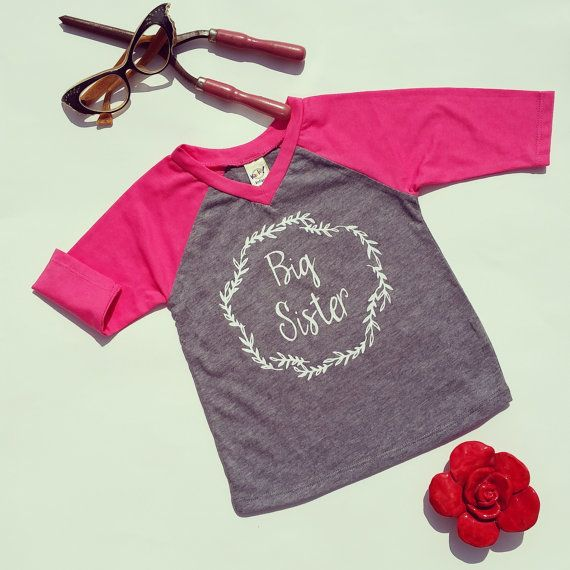 This would be so perfect for pictures or for meeting new baby brother/sister in the Hospital! This shirt is a quarter sleeve raglan available in lots of colors. Hand printed graphic that holds up between washes. The first picture is a quarter sleeve pink and gray raglan. Just choose