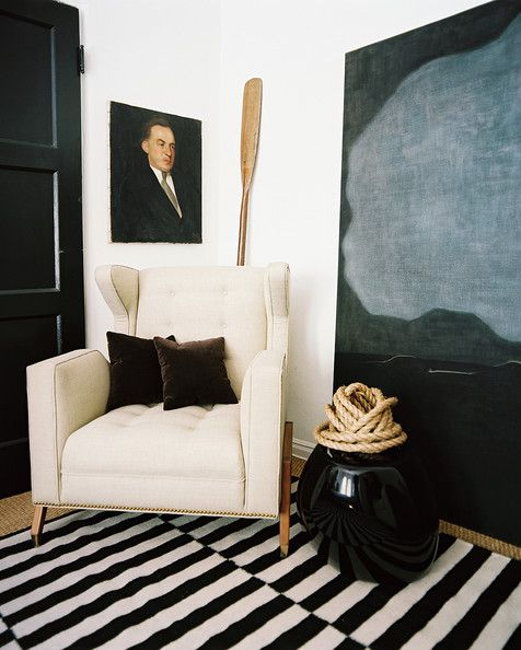 You know those empty corners of rooms you never know what to do with?  Well, cosy it up with a rug, some art and a sculptural chair.  The texture and contrast here is beautiful!