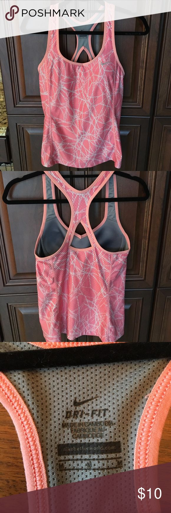 Nike dry-fit Workout Top Nike Dri-fit w/o Top. Really nice color. Light and dark peach. Tag reads medium, but imo a small.  I wear a medium, but I am busting out of this one. So sad, because I love it 😍.  Last photo accurate color. Nike Tops
