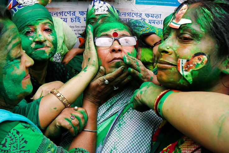 Rupak De Chowdhuri / Reuters Supporters of Trinamool Congress in Kolkata, India, celebrate after learning the initial poll results of the West Bengal Assembly elections.
