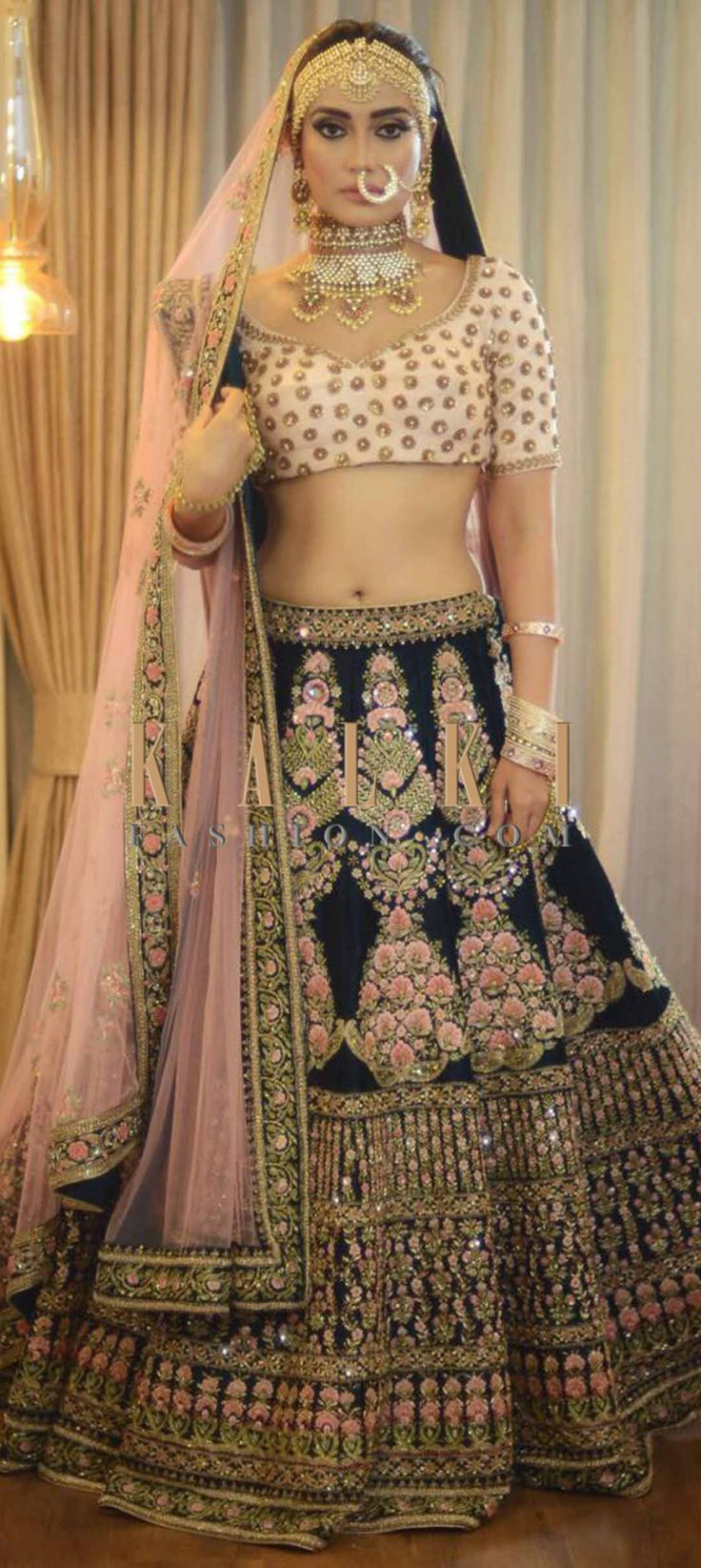 Buy Online from the link below. We ship worldwide (Free Shipping over US$100)  Click Anywhere to Tag Surbhi jyoti in Kalki dark green lehenga with peach blouse in resham embroideryDark green lehenga featuring in silk with peach blouse. Lehenga and blouse are embellished in resham, cut dana and sequin embroidery. Matched with embroidered dupatta in pink net.
