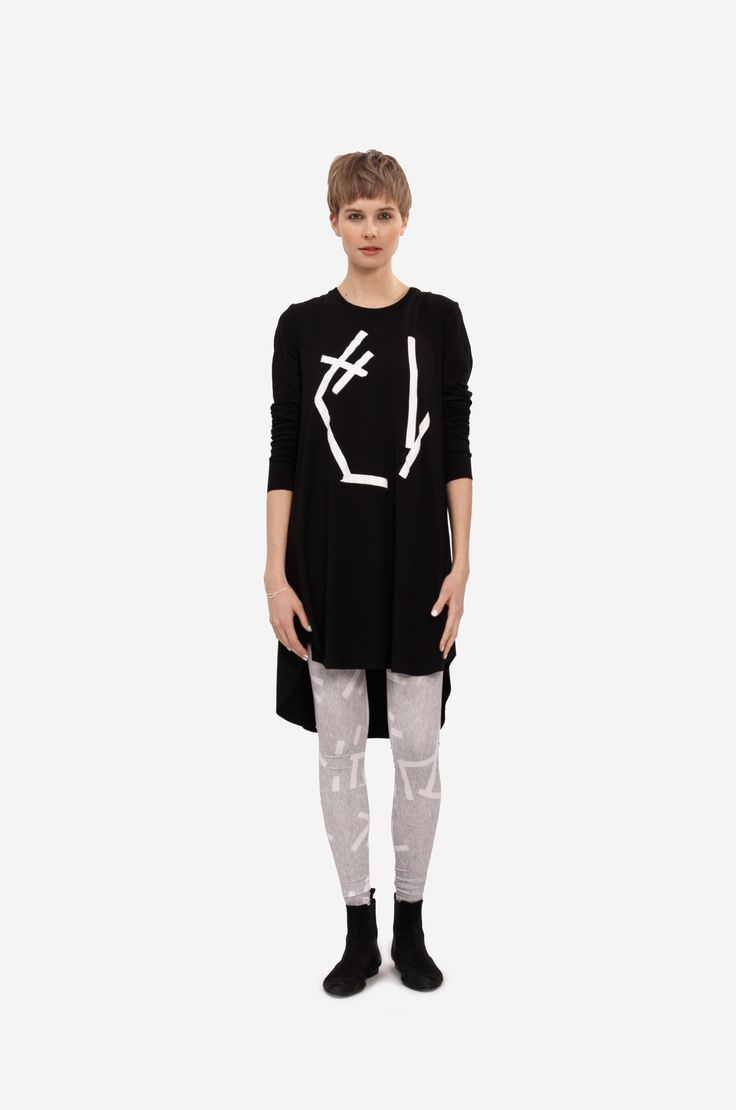 """DRESS """"ABSTRACT"""" WITH LONG SLEEVE Shorthaired model wearing an a-line dress with long sleeves and original print leggings."""