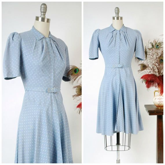 Vintage late 1930s day dress in a pale blue rayon blend faille that is sleek and springy. The entire piece is speckled with white screen printed Swiss polka dots. The sky blue tone is a perfect hue for the season, and the medium weight is ideal. The short sleeves have pleats for a bit of