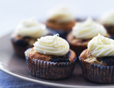Cupcakes with apples, liquorice and white chocolate frosting. I must try these!