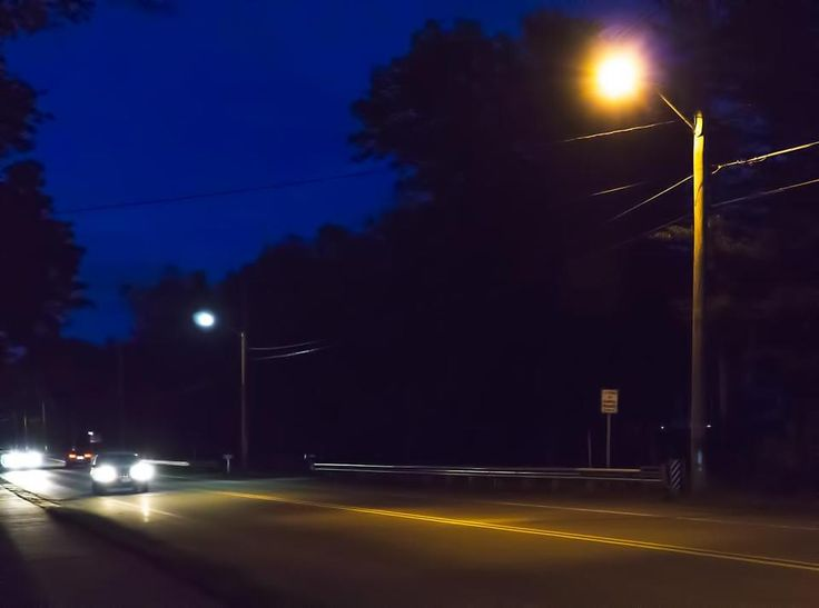 The difference in lighting color was evident on a recent night in Easton, from the LED street light in the background and the high-pressure sodium light in the foreground that is more orange and less like daylight.