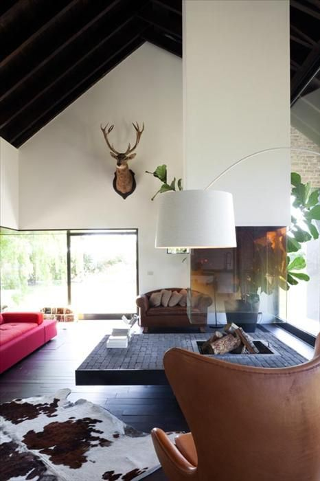 fireplace and coffee table in one - that's a novel idea.