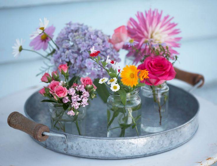 flowers in jam jars