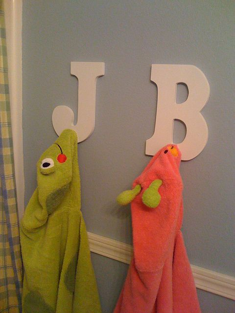 Towel Racks - easy to DIY with letters from Hobby Lobby and pegs from Home Depot. Would be cute as a coat hanger also. ;)