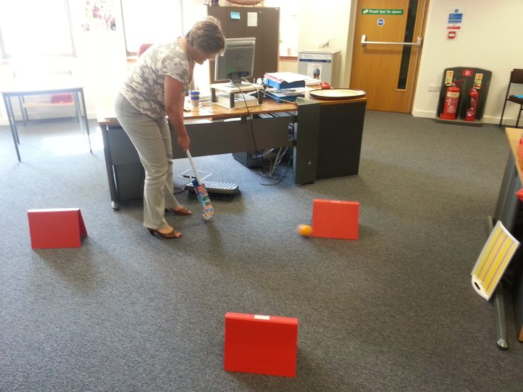 To celebrate #India's national sports day we invented some office sports to take part in. Here is Isabel playing croquet!