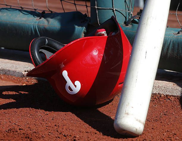 Philadelphia Phillies batting helmet sits on the field before the start of an MLB game against the Washington Nationals at Citizens Bank Park on...