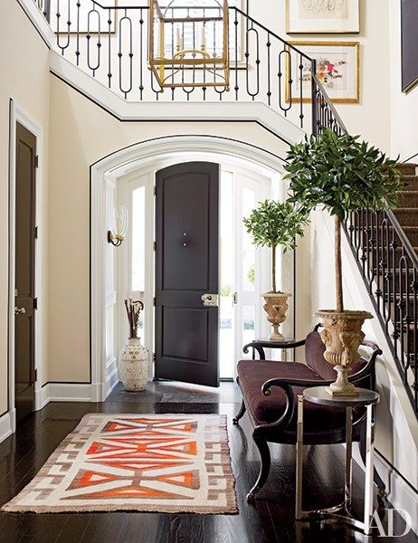 At the Houston home of interior designer J. Randall Powers and investor William L. Caudell, custom-made moldings amplify the elegance of the entrance hall.