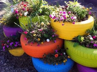 recycled used tires spray painted and used as pottery for plants