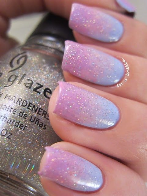 Pastels & glitter mani (by Gems in a Bottle).  She started with a coat of pastel burple from LAKA, then sponged on some Essie Castaway at the tips.  Then she sponged some Orly Lift the Veil to make the transition of the two colors smoother. Top coat is China Glaze Fairy Dust.
