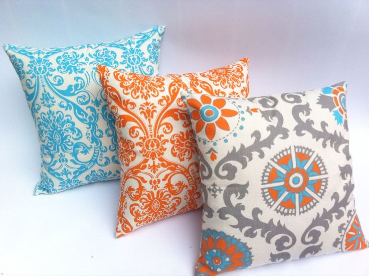 THREE Turquoise and Orange Decorative Throw Zipper Pillow Covers Set of Three Turquoise Orange Pillow Blue and Orange Pillow 18x18 Inches by Pillomatic on Etsy https://www.etsy.com/listing/161226668/three-turquoise-and-orange-decorative
