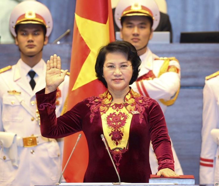 Nguyễn Thị Kim Ngân takes the oath of office after being elected as chairwoman of the National Assembly in Hanoi, Vietnam Thursday, March 31, 2016.