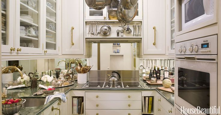 A mirrored backsplash, an electric cooktop that doubles as countertop, and simple cabinetry give the illusion of grandeur in Stokes's tiny kitchen. She designed a specific space for every pot, plate, and peppermill.