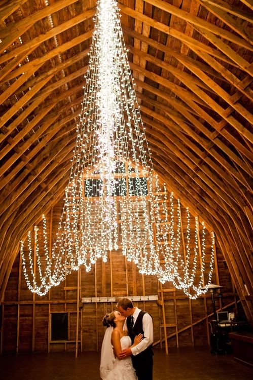 Wow check out the lights and its in a barn... THIS! #TwinkleLights #Wedding #Barn