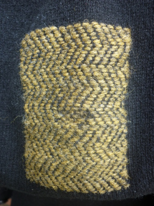 darning in herringbone pattern by Tom of Holland. Part of the Visible Mending Programme.