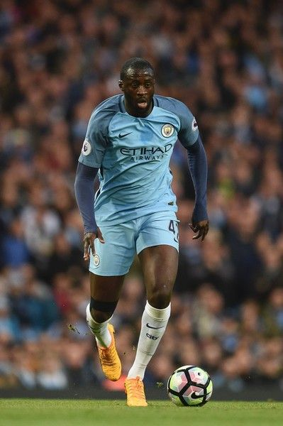 Manchester City's Ivorian midfielder Yaya Toure runs with the ball during the English Premier League football match between Manchester City and Manchester United at the Etihad Stadium in Manchester, north west England, on April 27, 2017. / AFP PHOTO / Oli SCARFF / RESTRICTED TO EDITORIAL USE. No use with unauthorized audio, video, data, fixture lists, club/league logos or 'live' services. Online in-match use limited to 75 images, no video emulation. No use in betting, games or single…