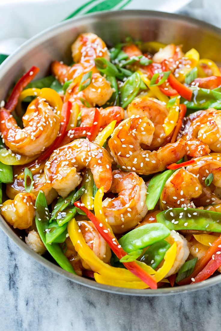 This recipe for teriyaki shrimp stir fry is shrimp and vegetables coated in a homemade teriyaki sauce and served over brown rice.