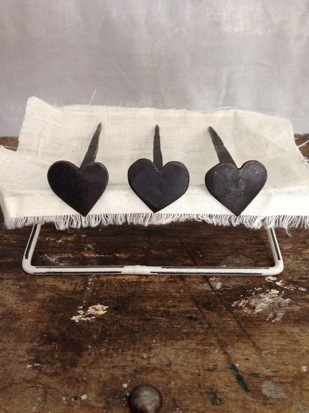 3 hand forged heart nails.