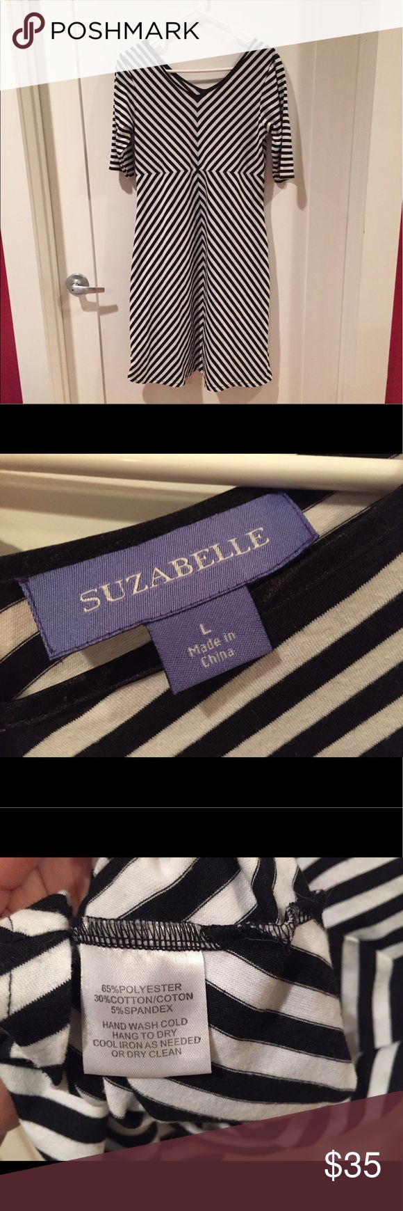 "✨Just reduced!✨ Geometric stripe b&w jersey dress Super-comfy and chic black and white striped dress by Suzabelle. Size L. Waist 34"", length 40"" from shoulder to hem. Polyester/cotton/spandex.  Worn only a few times.  Perfect with heels for work or boots or flats for an easy weekend outfit! Suzabelle Dresses"