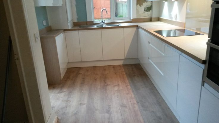 recent example of wood worktop with wood effect floor