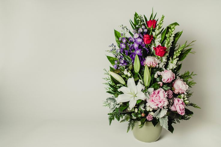 Flower arrangement with peonies, orientals, snapdragons, delphinium, and roses - Donvale Flower Gallery