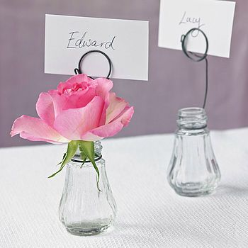 Vase place card holder - make them out of salt and pepper shakers and wire