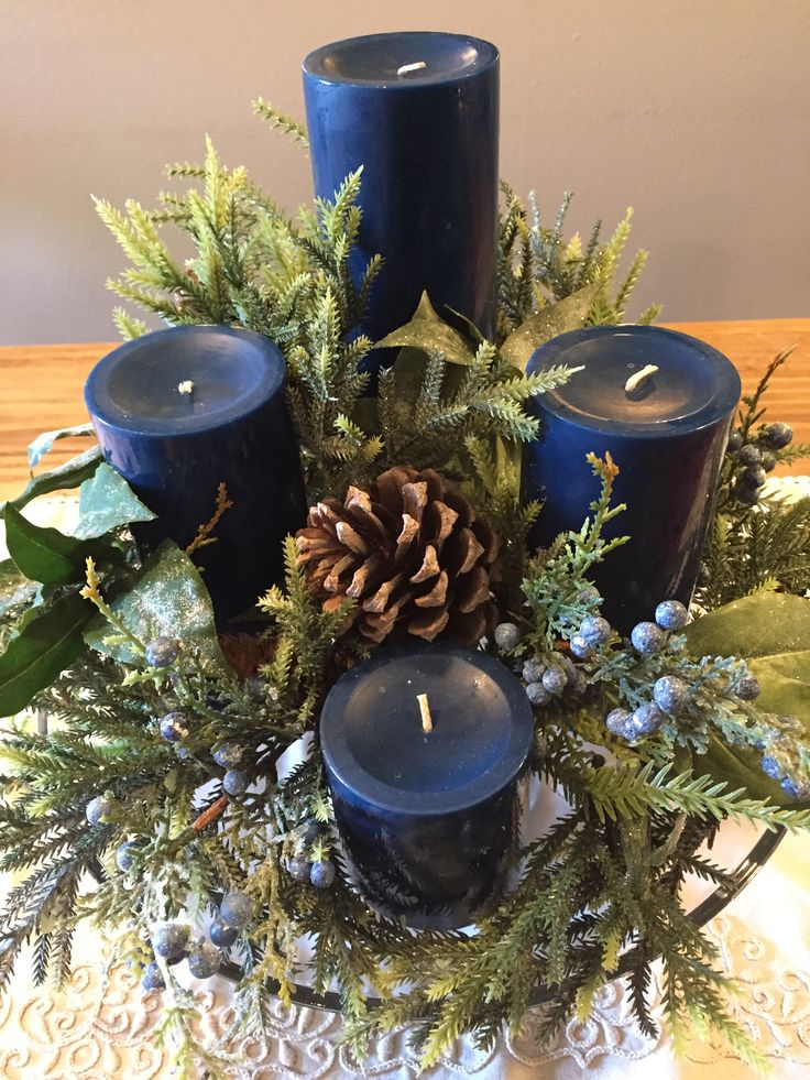 Advent wreath I used a clear cake stand I owned, bought a wreath on sale at Michaels and took it apart for the greenery. Blue isn't my usual Christmas decorating color, but it's a color of Advent.