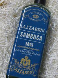 SAMBUCA LAZZARONI 1851 LIQUER 0.7L Το Lazzaroni Sambuca 1851 ηδύποτο είναι ένα μίγμα του πλούσιου, γλυκού ηδύποτου και μεγλυκάνισο αστεριών, με γλυκιά επίγευση.