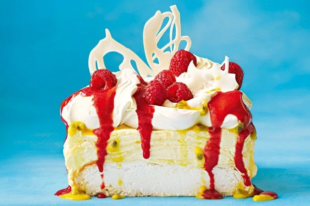 This pavlova cheesecake is a dream come true, with a creamy curd layer and a fruity burst of raspberries.