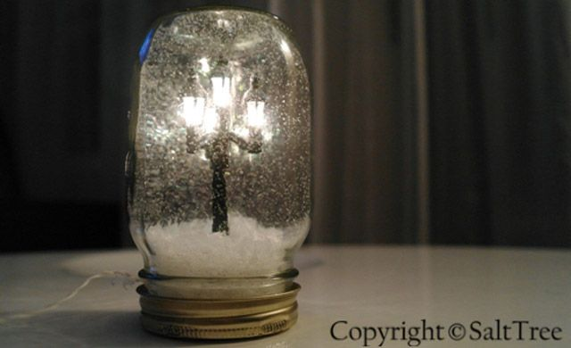 Mason Jar Crafts - DIY Christmas Village Lighted Snow Globe in a Mason Jar   #crafts #masonjars via Put it in a Jar (putitinajar.com)