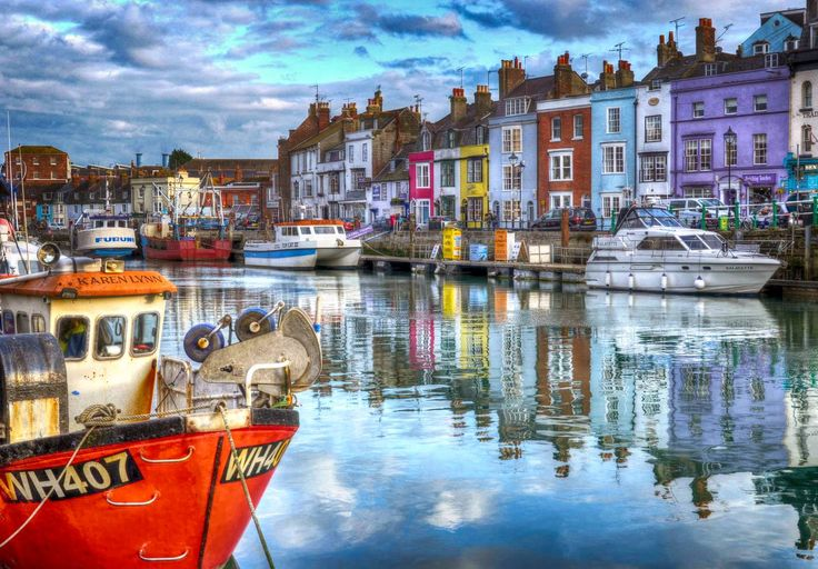 The colorful houses lining the Old Harbour of Weymouth in Dorset, England.