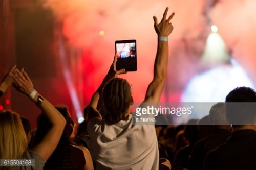 01-14 Man shooting live music concert through digital tablet. #vrhnika... #vrhnika: Man shooting live music concert through… #vrhnika