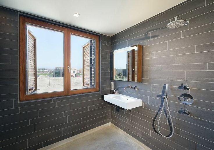 Hotels & Resorts, Villa Rieteiland-Oost by Egeon Architecten Presents Village Nuance: Modern Bathroom With Black Tile And Grey Floor Theme