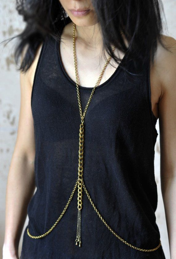 Love this gorgeous body chain, made of Brass (nickel free) and featuring 3 different kinds of chain. Three little brass drops hang from the thick chain giving this piece movement. For DIY- know there is a clasp on the neck & waist, and it can be worn as a necklace too!