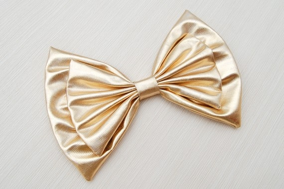 Giant gold lame hair bow